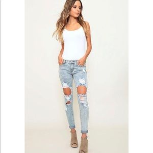 Denim - Light Washed Distressed Mid Rise Skinny Jeans